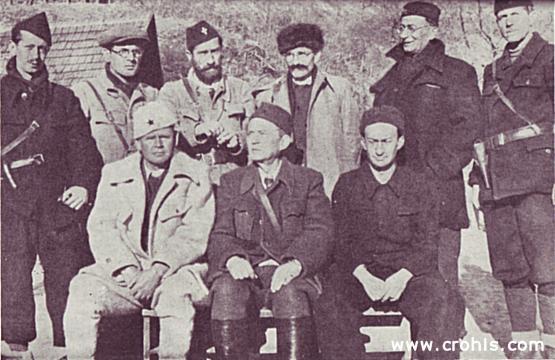 Izvršni komitet AVNOJ-a. Izvršni odbor AVNOJ-a (Antifašističko vijeće narodnog oslobođenja Jugoslavije) izabran na zasjedanju u Bihaću (26/27. 11. 1942.). Snimljen 1943. negdje u Crnoj Gori. Sjede: (s lijeva na desno) Nurija Pozderac, Ivan Ribar i Pavle Savić. Stoje (s lijeva na desno): Mladen Iveković, Veselin Masleša, Vlada Zečević, Ivan Milutinović i Mile Pruničić. Izvršni odbor AVNOJ-a trebao je predstavljati začetak buduće jugoslavenske vlade.